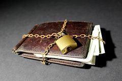 Wallet with money wrapped in a chain and lock royalty free stock photography