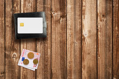 Wallet, money and credit card on wooden table Stock Images