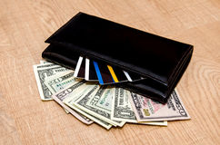 Wallet with money, credit cards and notepad Stock Photography