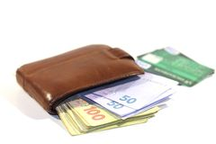 Money and credit cards. Wallet, money and credit cards on a white background Royalty Free Stock Images