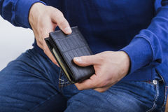 Wallet with money in the hands of a man Royalty Free Stock Photo