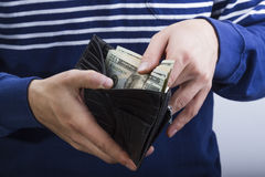 Wallet with money in the hands Royalty Free Stock Images