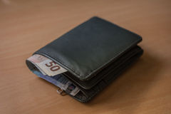 Wallet with money inside Stock Photography