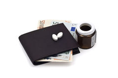 Wallet with money and medicine Royalty Free Stock Image