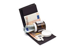 Wallet with money and medicine Royalty Free Stock Photos