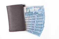 Wallet and money over white Stock Images