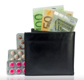 Wallet with money and several varieties pills Stock Photos
