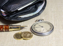 Wallet with money and vintage watch. Black wallet with money and vintage watch and fountain pen Royalty Free Stock Photography