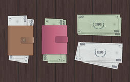 Wallet&Money. Wallets & Money: two colors. Wooden background Stock Images