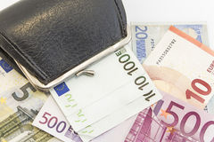 Wallet with money  on white Royalty Free Stock Photos