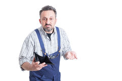 Wallet with no money in mechanic hand looking sad Stock Photography