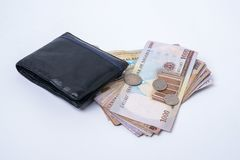 Wallet with Notes and Coins. Folded Wallet with Naira Bank Notes and Coins stock photography