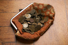 Wallet with old collection coins. Old retro,vintage woman wallet with old collection coins on wooden background Stock Photography