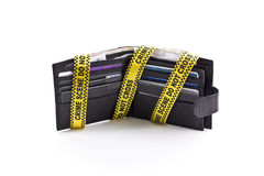Wallet open with crime scene tape Royalty Free Stock Image