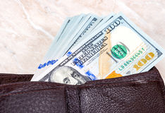 Wallet open with a one hundred american dollar bills Stock Photography