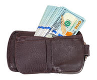 Wallet open with a one hundred dollar bills sticking out Stock Images