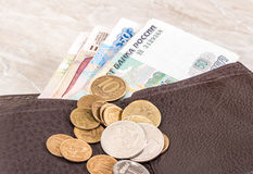 Wallet open with russian rubles banknotes and coins Stock Images