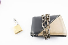 Wallet, padlock and chain. Wallet with chain and open padlock, on a white background Stock Photo