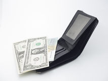 A wallet with paper money and gold bracelet Stock Image