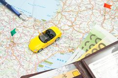 Wallet, pen and sport car on map of Europe Royalty Free Stock Images