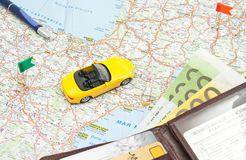 Wallet, pen and yellow car on map of Europe Stock Photos