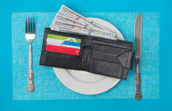 Wallet in a plate Stock Images