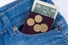 Wallet and ready money are lying in side pocket of blue jeans royalty free stock photos