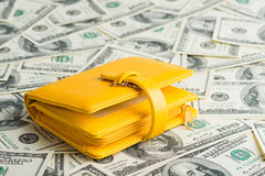 Wallet Resting Upon Many United States One Hundred Dollar Stock Images