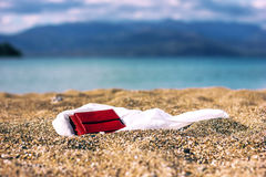 Wallet on sand Stock Image