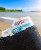 Wallet on Seaside Background Royalty Free Stock Image