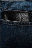 Wallet showing back pocket of jeans Royalty Free Stock Photography