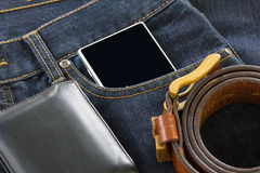 Wallet and smartphone on denim jeans Stock Photos