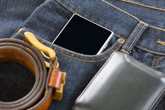 Wallet and smartphone on denim jeans Royalty Free Stock Images