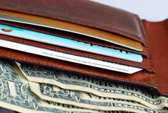 Wallet with some credit cards and cash. A wallet with some credit cards and cash Stock Photo