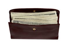 Wallet stuffed with money Stock Images