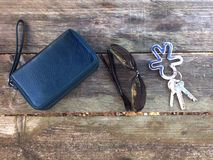 Wallet, sunglasses and keys Stock Photos