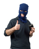 Wallet Thief. A thief holding a wallet and giving a thumbs up, isolated against a white background Royalty Free Stock Photo