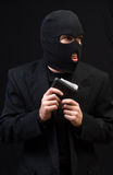 Wallet Thief. A wallet thief wearing a black balaclava and holding a leather wallet Stock Images