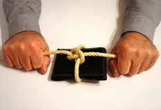 A wallet tied with a rope, in a man`s hand. On the white background Royalty Free Stock Photo