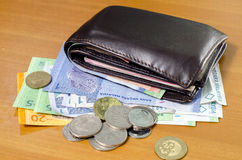 Wallet On top of money Royalty Free Stock Photography