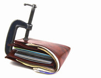 Wallet trapped in G clamp stock photos