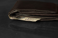Wallet with twenty pound notes on a table Stock Photo