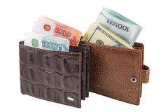 Wallet. The two brown  leather wallet with euro, dollars and rubles is photographed on the close-up Royalty Free Stock Photography