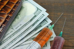 Wallet With US Dollar Cash And Two Syringe Stock Photography