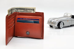 Wallet with US Dollars and blured old toy car background Royalty Free Stock Photography