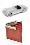 Wallet with US Dollars on blured Toy car background Stock Photos