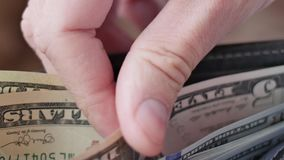 Wallet with US dollars inside. stock footage