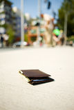 Wallet: Wallet On Sidewalk While Man In Background Checks Pocket Royalty Free Stock Photography