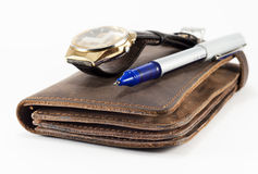 Wallet, watch and pen. Men's accessory- leather wallet, watch and pen on white royalty free stock photography