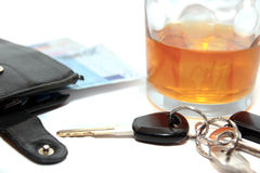 Wallet whiskey car keys and euro cash Royalty Free Stock Photography